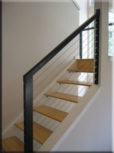Custom contemporary cable railing with floating stairs